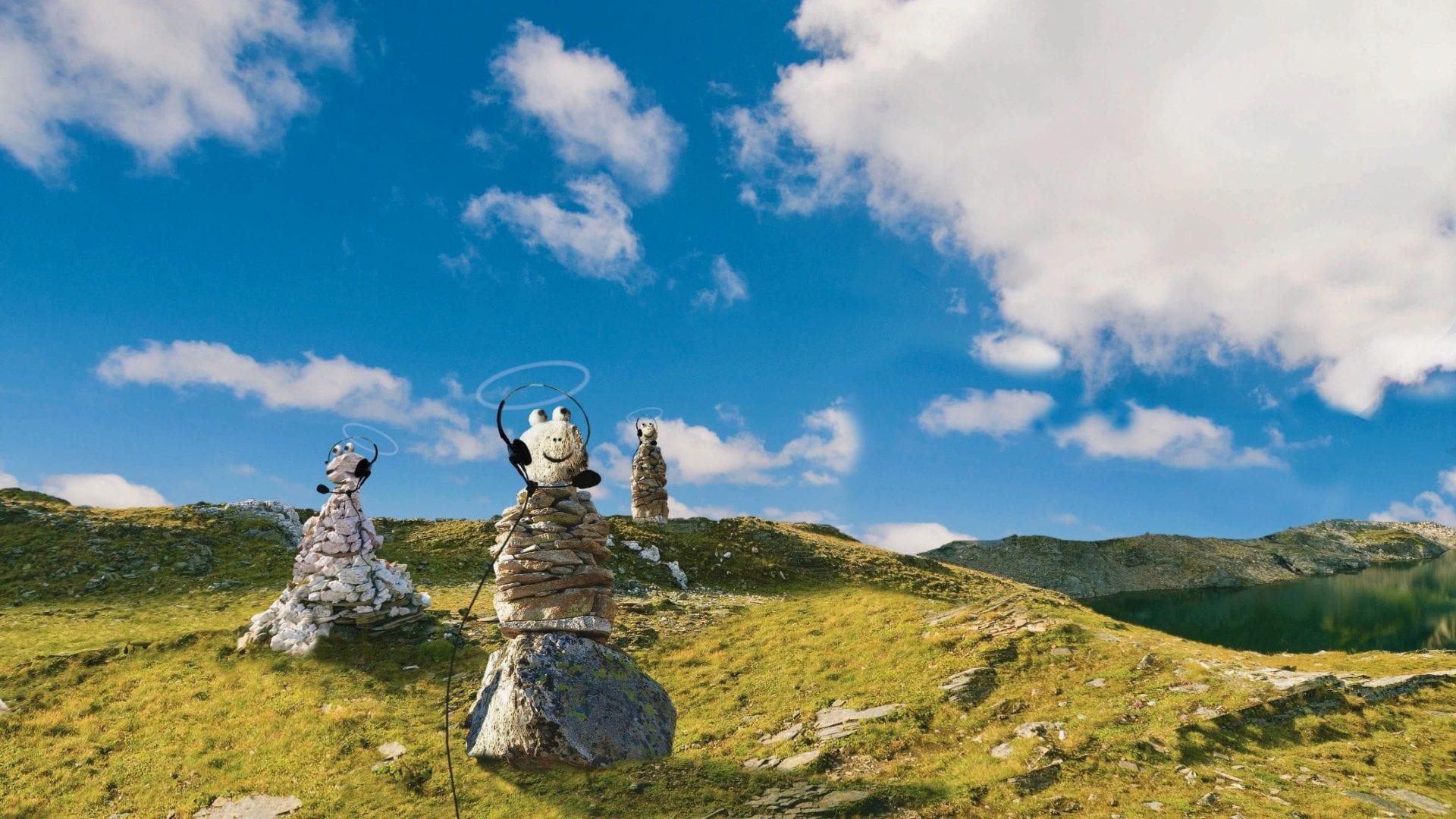 Steinmännchen mit aufgezeichneten Kopfhörern